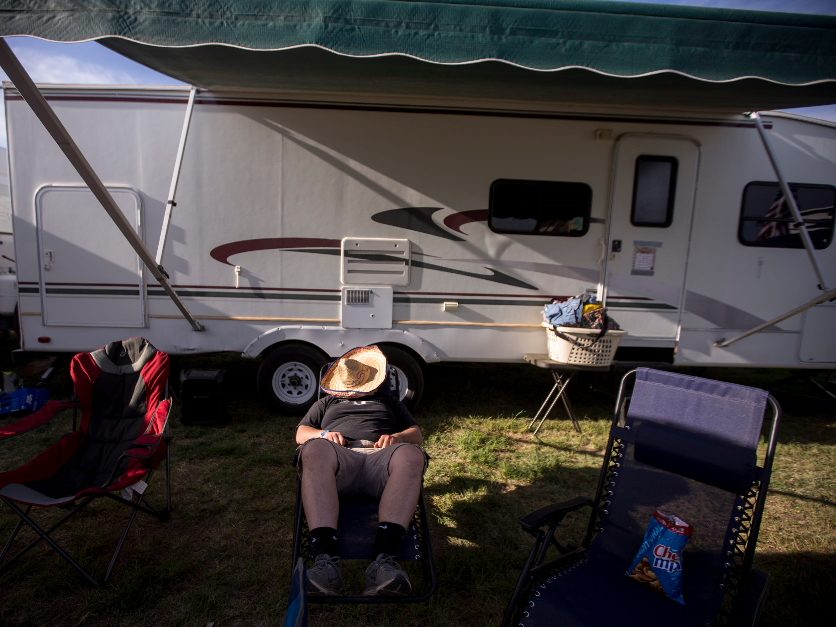 Garrett Flack sleeps at a campsite during Day 1 of Country Thunder Arizona in Florence, Ariz., on Apr. 11, 2019.
