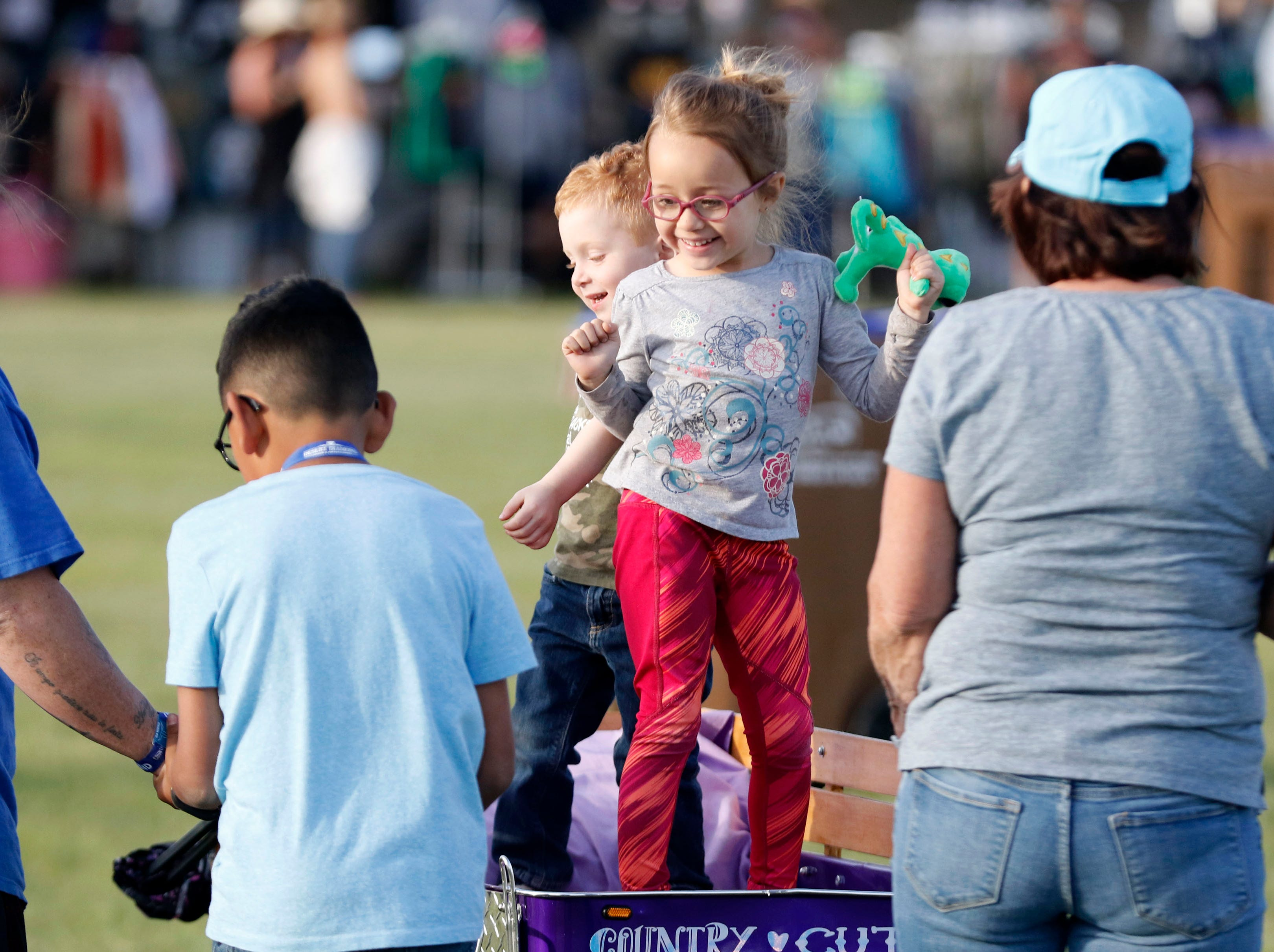 Calliope Finsad 4, of Tucson dances with her little brother Robert during Country Thunder Arizona on April 11, 2019, in Florence, Arizona.