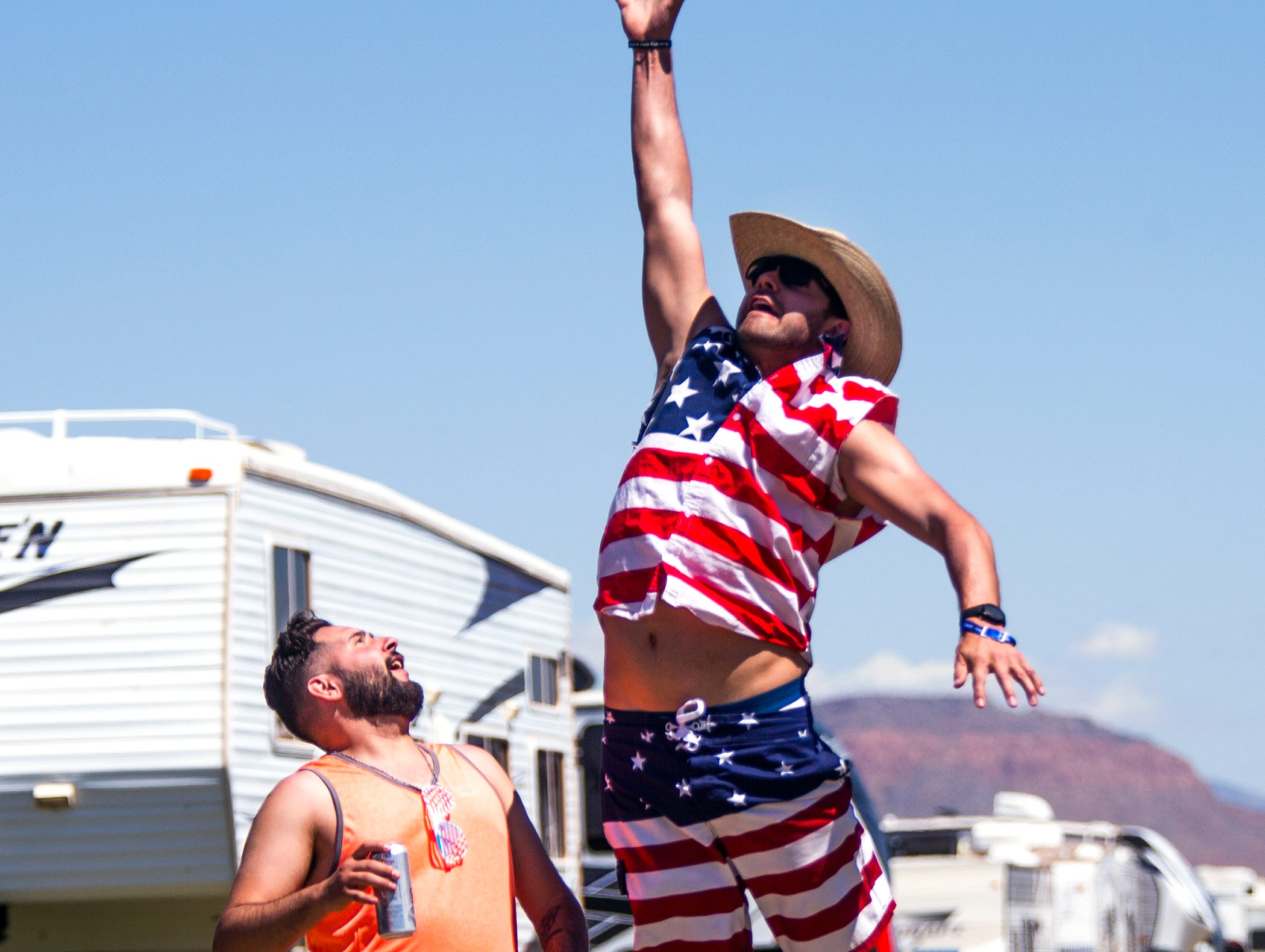 Fans toss the football around in camp at the Country Thunder Arizona 2019 music festival, Thursday, April 11, 2019.
