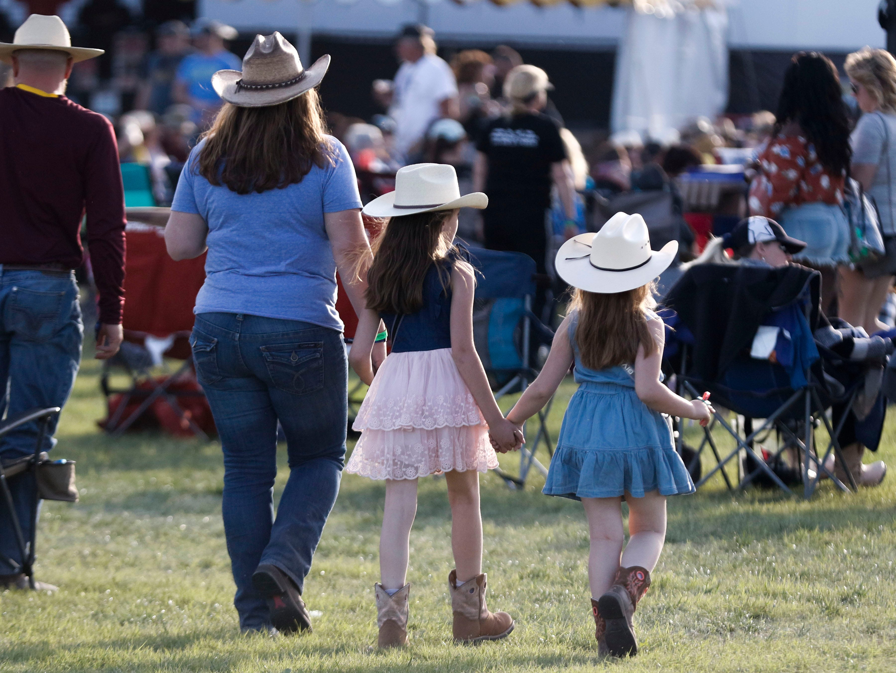 Young and old, all the ladies are dressed for Country Thunder Arizona on April 11, 2019, in Florence, Arizona.