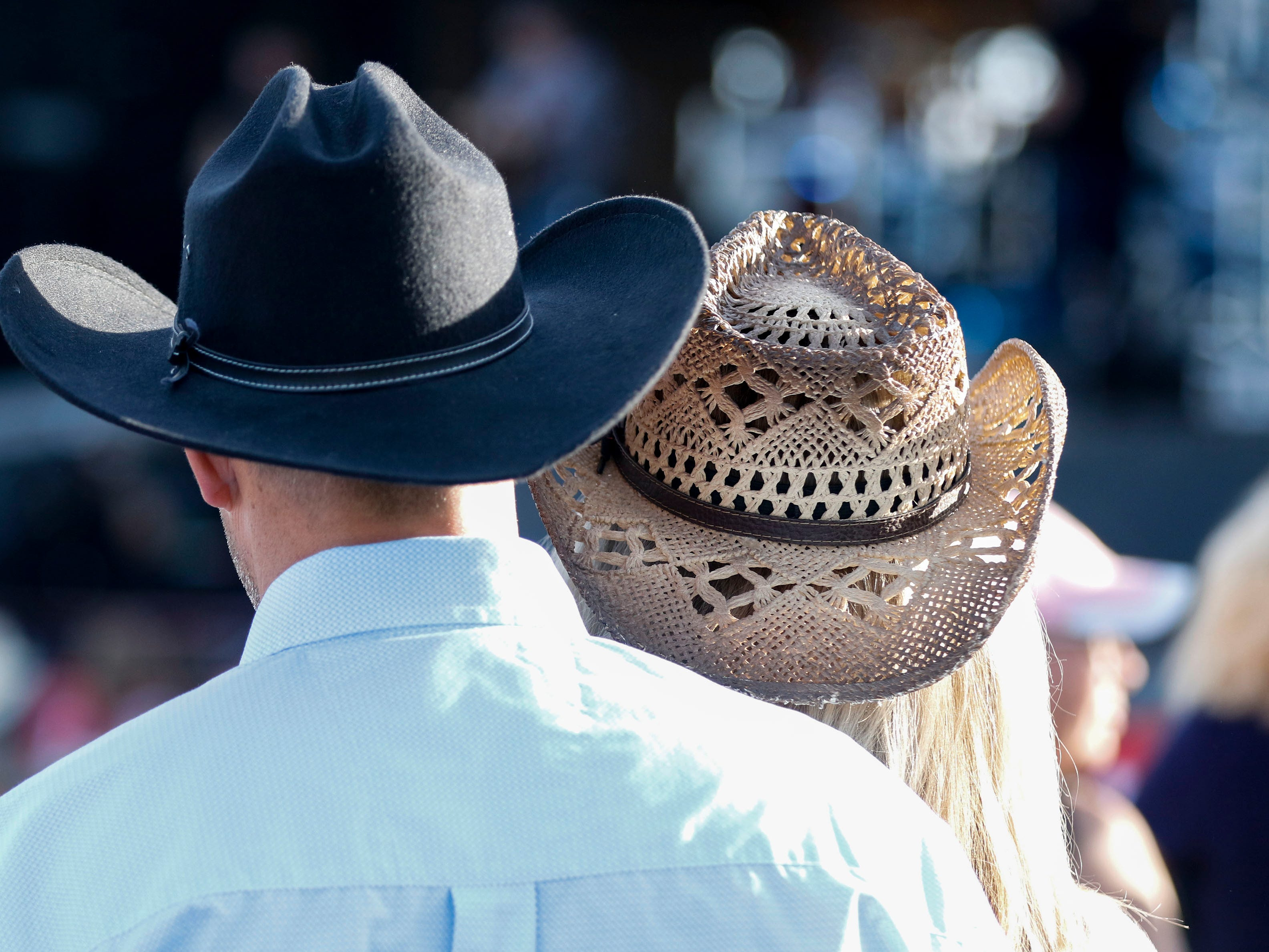 A couple listens to Harry Luge during Country Thunder Arizona on Thursday, April 11, 2019, in Florence, Arizona.