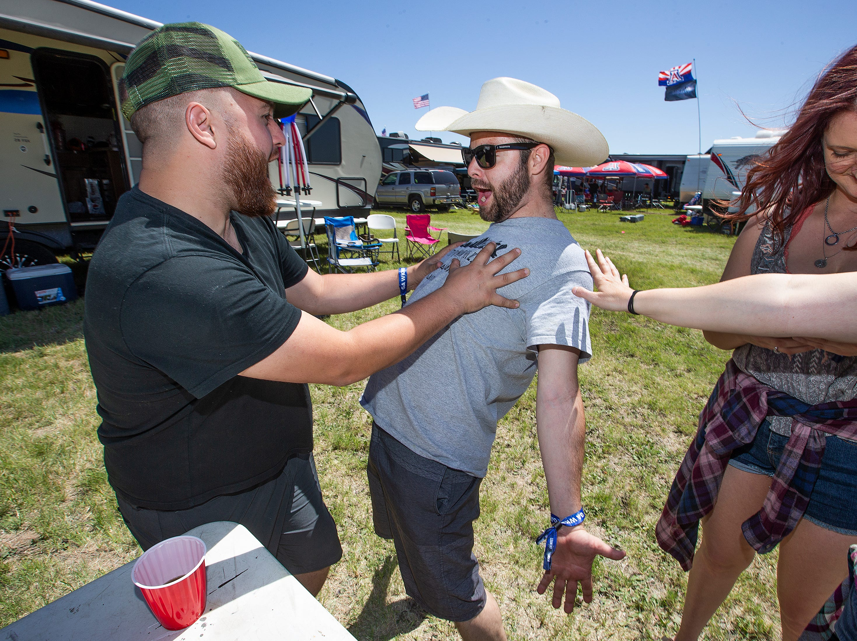 Josh Rivera, 28, Phoenix, left, and Joseph Weaver,28, Henderson, Nevada, have fun at Country Thunder Arizona 2019 Thursday, April 11, 2019.