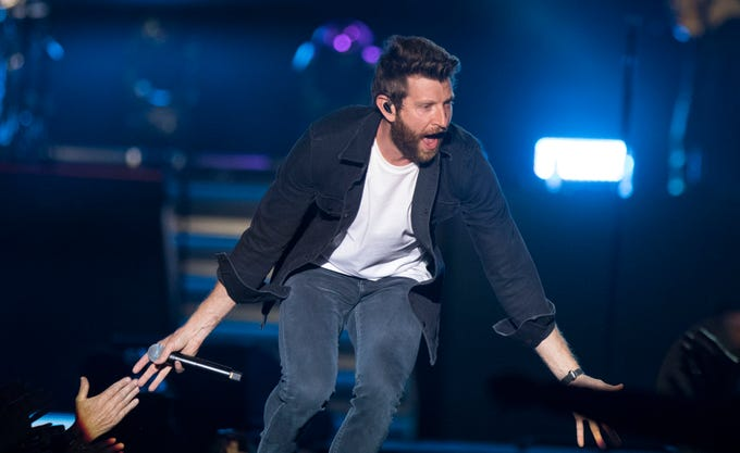 Brett Eldredge high-fives fans during Country Thunder Arizona April 11, 2019, in Florence.