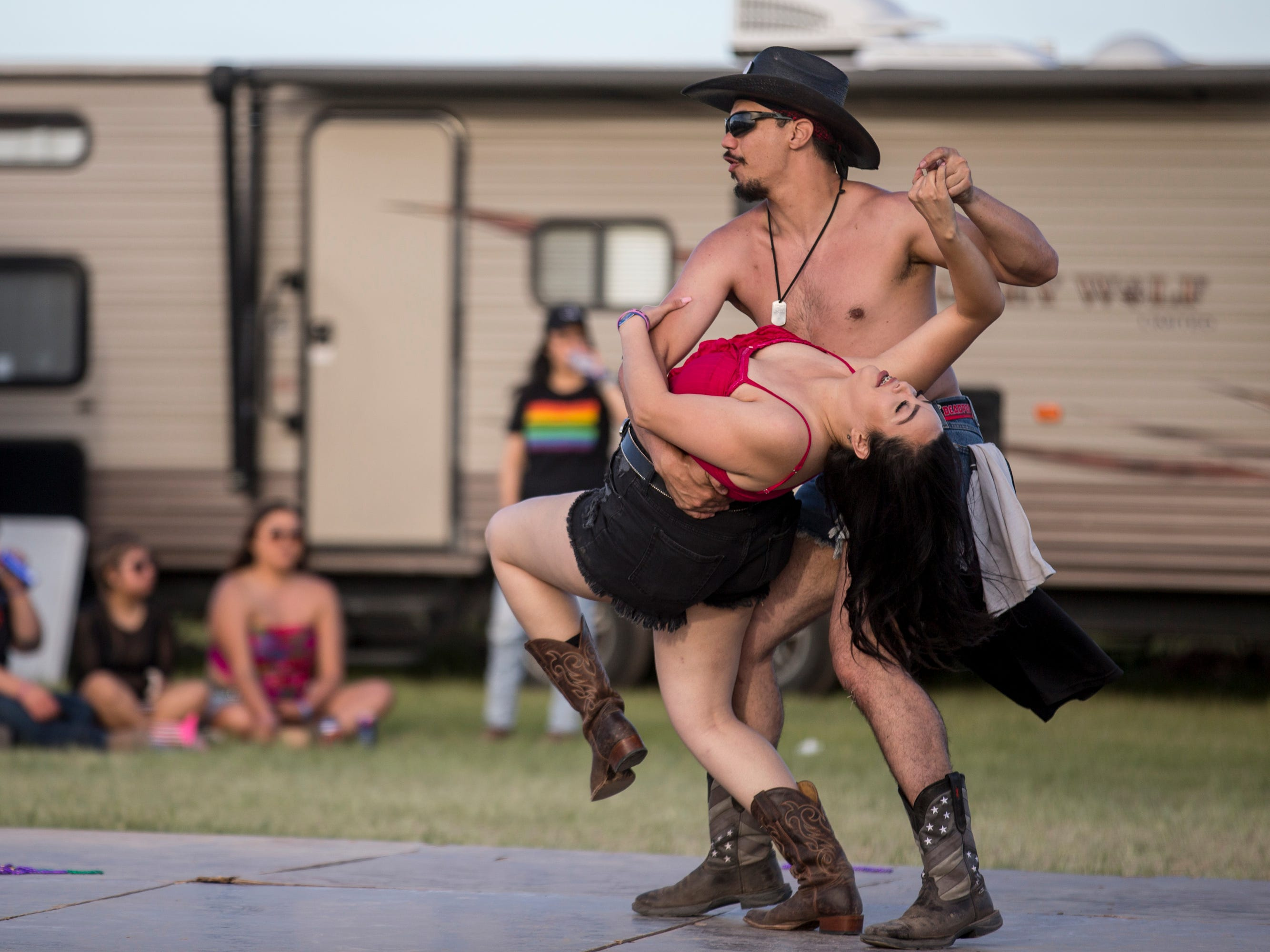 Joseph McCann dips Diana Manzo at the Crazy Coyote campsite during Day 1 of Country Thunder Arizona in Florence, Ariz., on Apr. 11, 2019.