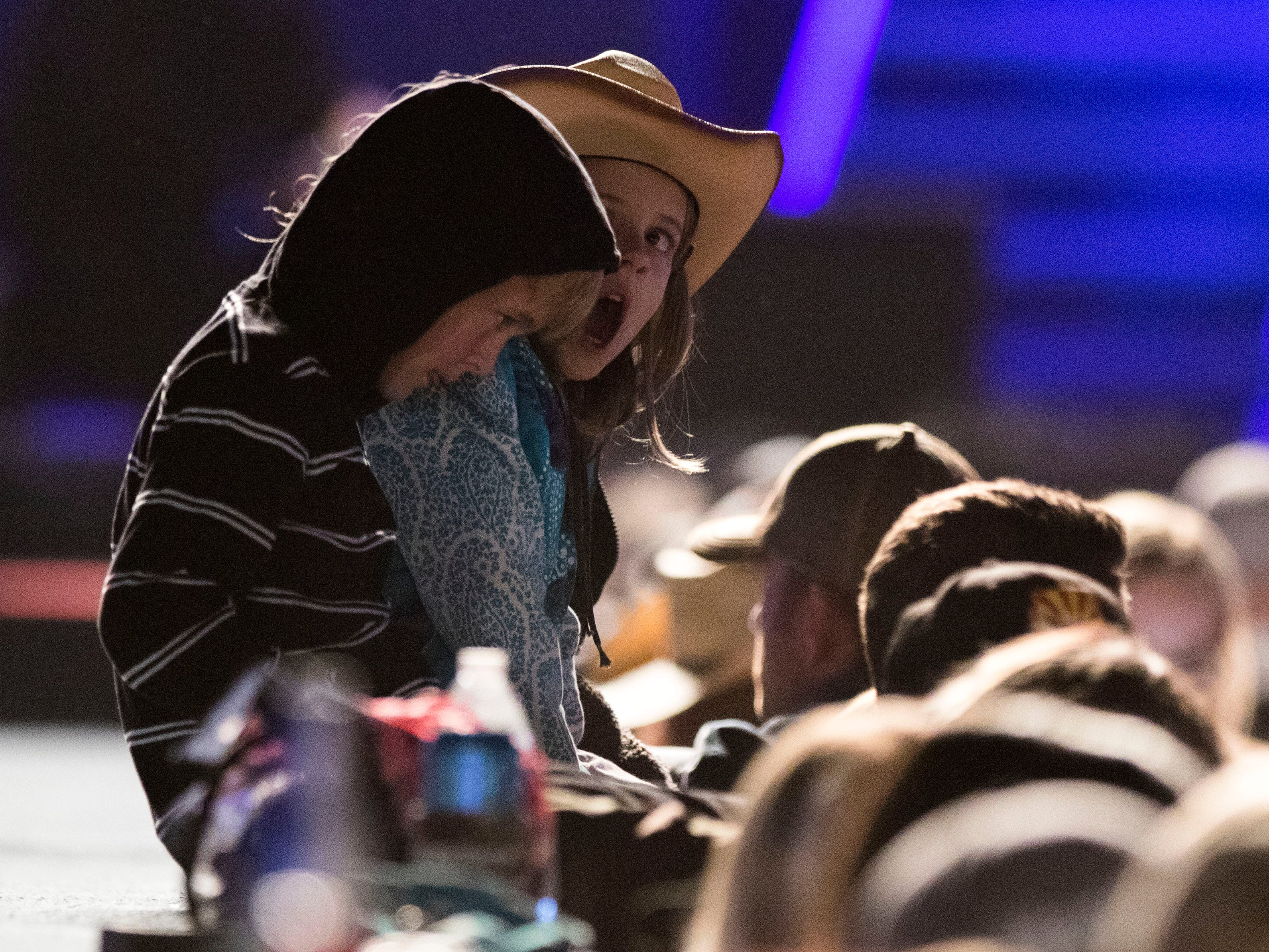 A couple of tired little music lovers wait for Brett Eldredge the last act of the night during Country Thunder Arizona Thursday, April 11, 2019, in Florence, Ariz.