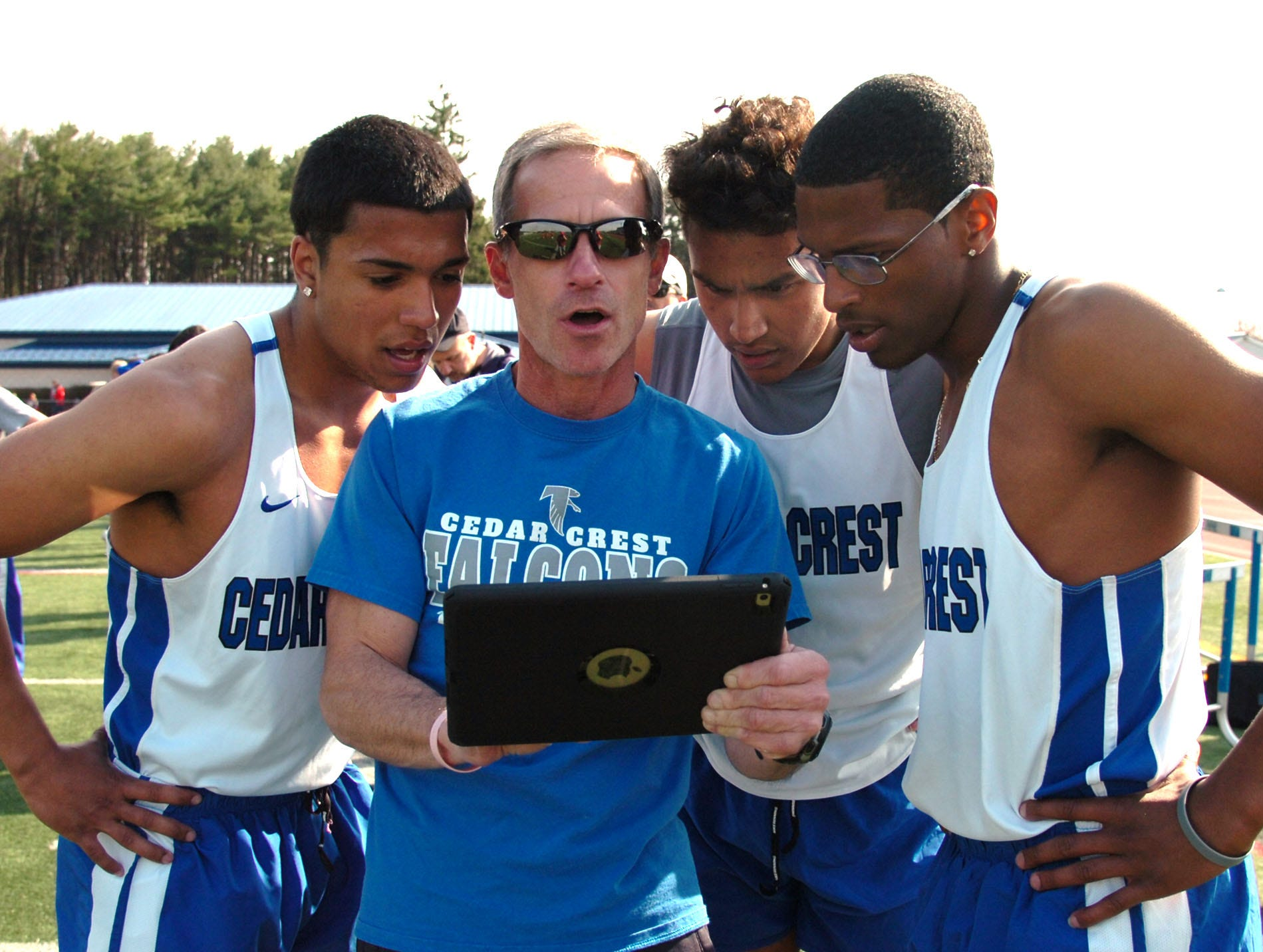 Rob Bare huddling with his runners