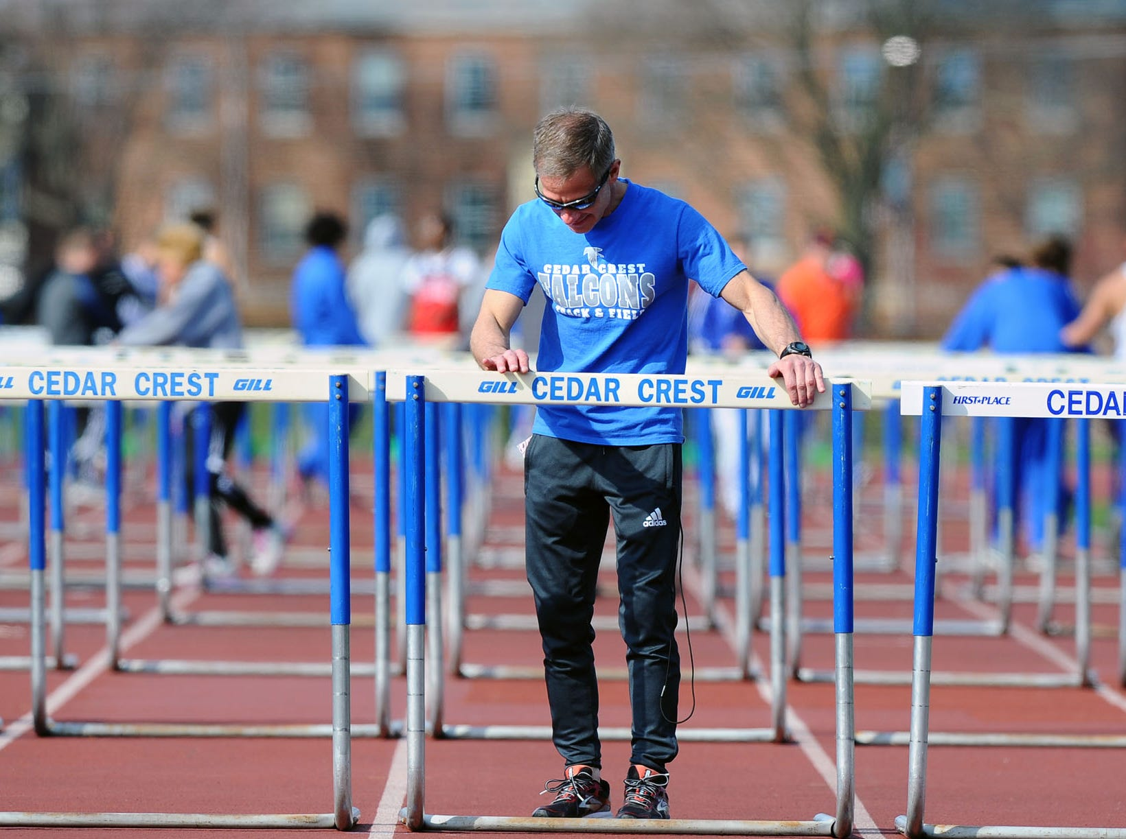 Rob Bare adjusting the hurdles prior to a race.