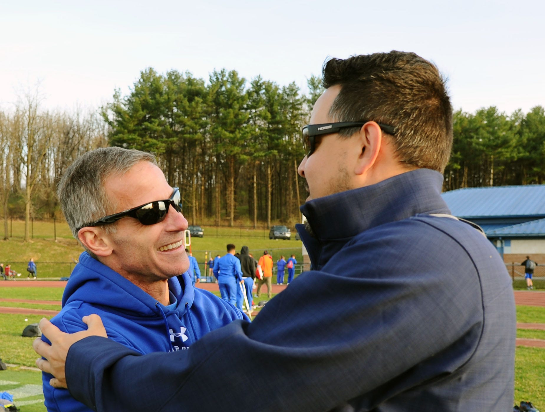 Rob Bare is congratulated by Lebanon assistant Keith Rolon.