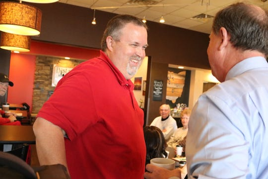 """Newly appointed Port Clinton Mayor Mike Snider, left, speaks with Ottawa County Municipal Court Judge Frederick """"Fritz"""" Hany on Wednesday."""