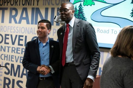 Port Huron City Manager James Freed, left, shakes hands with Lt. Gov. Garlin Gilchrist II Friday, April 12, 2019 after Gilchrist spoke with local community members at The Underground in Port Huron.