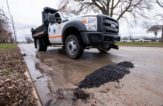 A Marysville DPW truck drives over a freshly-patched pothole to smooth it out Friday, April 12, 2019 along Huron Avenue in Marysville. This year, the county has only used 214.8 tons of cold patch, which is down from last year's 637.65 tons, according to St. Clair County Road Commission Managing Director Kirk Weston.