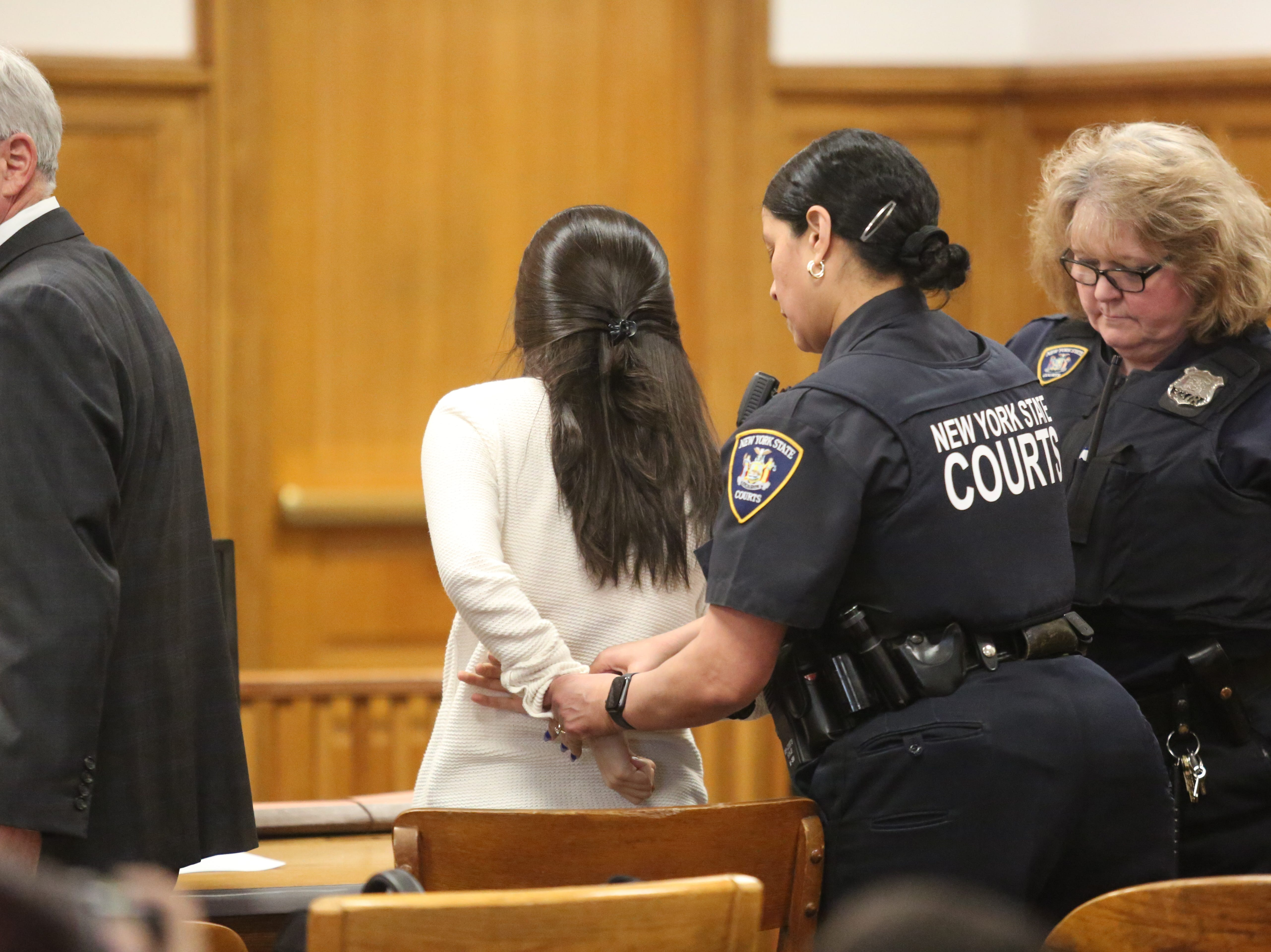 Nicole Addimando is handcuffed after she was found guilty of second-degree murder in the shooting death of Christopher Grover on April 12, 2019.