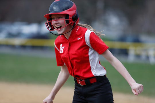 Red Hook's Sarah Scott reacts to the end of an inning following her at bat during Thursday's game versus Highland on April 11, 2019.