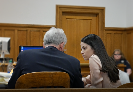 Nicole Addimando speaks with one of her defense attorneys, Benjamin Ostrer, in Dutchess County Court on April 4, 2019.