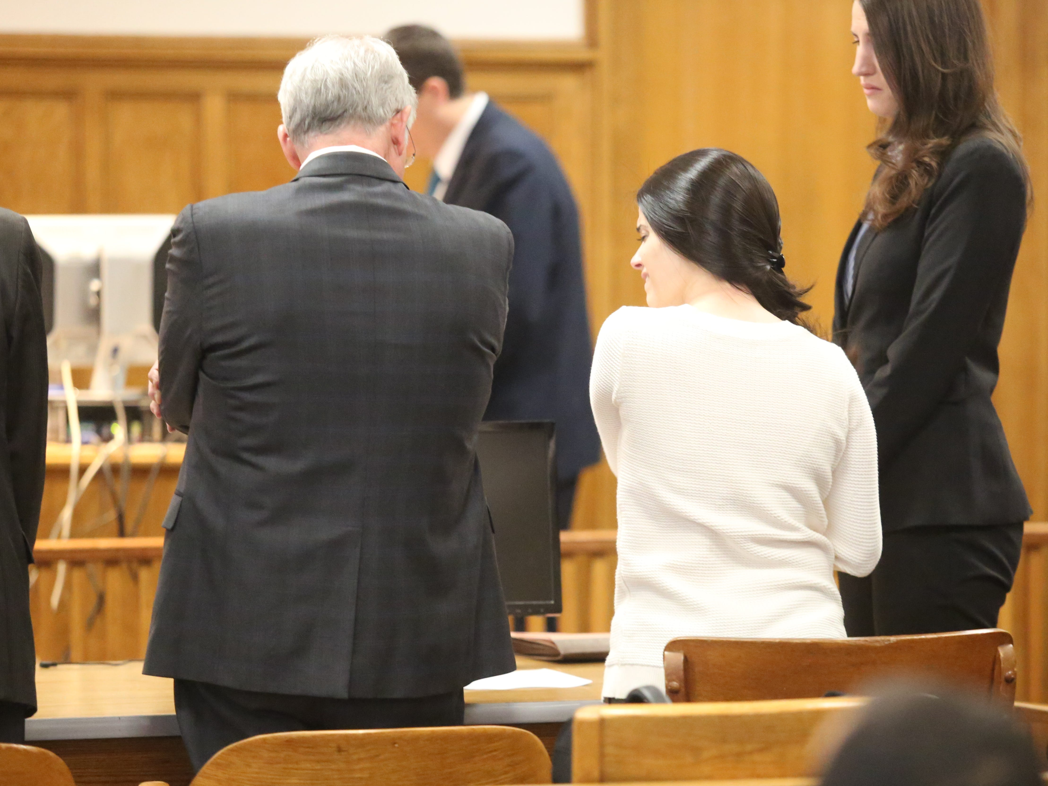 Nicole Addimando reacts after she was found guilty of second-degree murder in the shooting death of Christopher Grover on April 12, 2019.