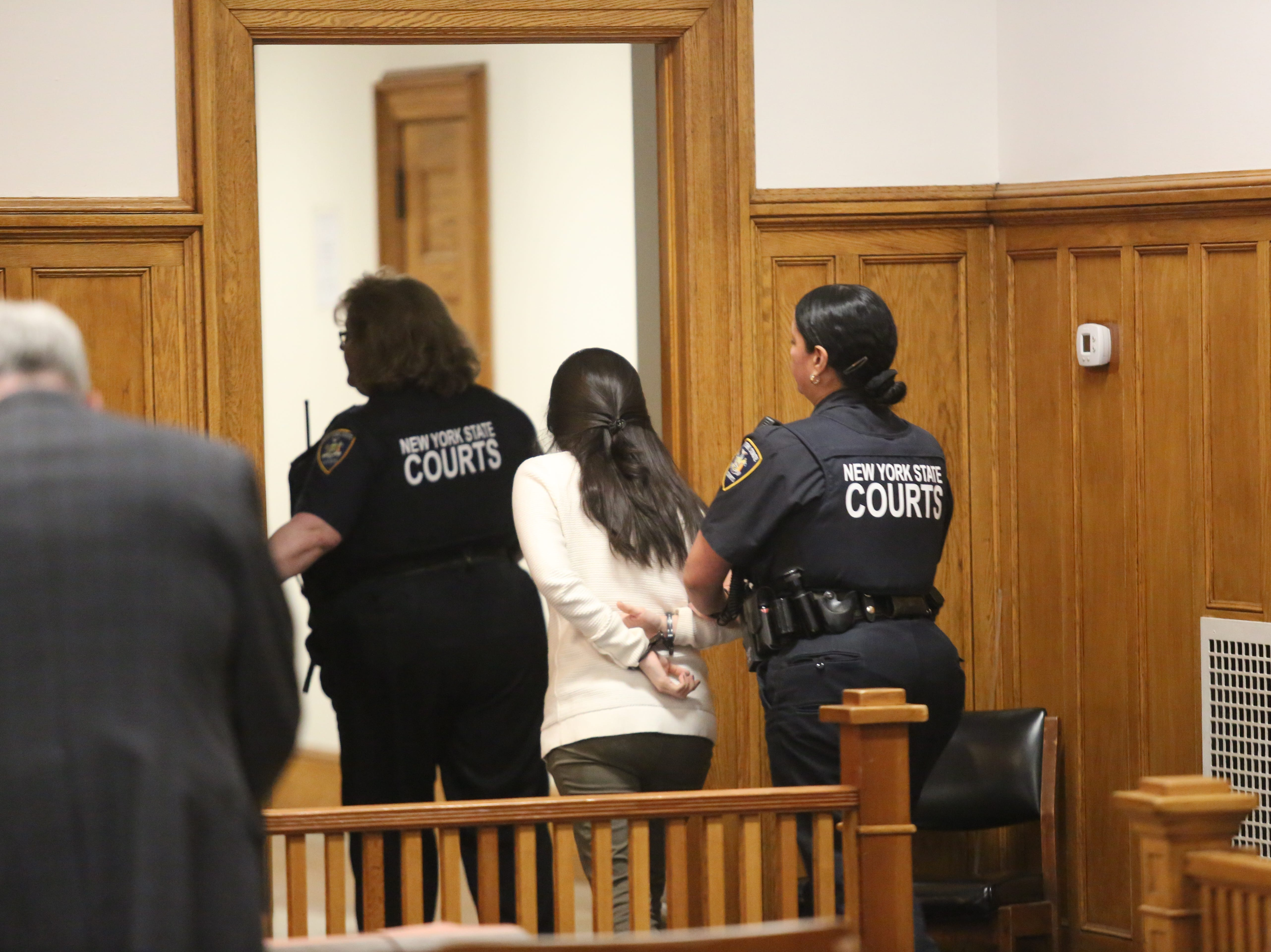 Nicole Addimando is taken out of Dutchess County Court in handcuffs after she was found guilty of second-degree murder in the shooting death of Christopher Grover on April 12, 2019.