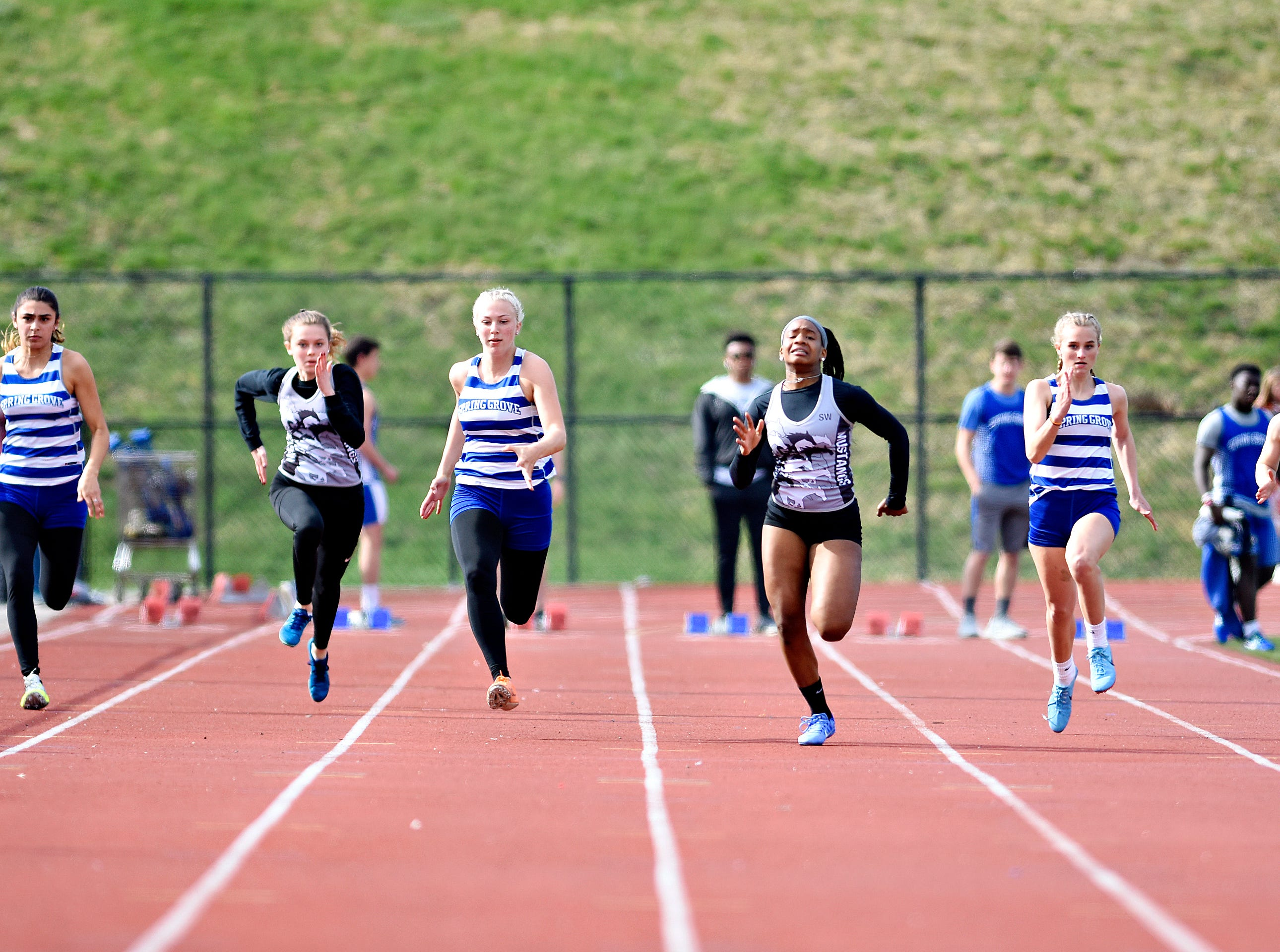 South Western's Zaiyah Marshall, third from right, wins the 100 Yard Dash during track action against Spring Grove in Jackson Township, Thursday, April 11, 2019. Dawn J. Sagert photo
