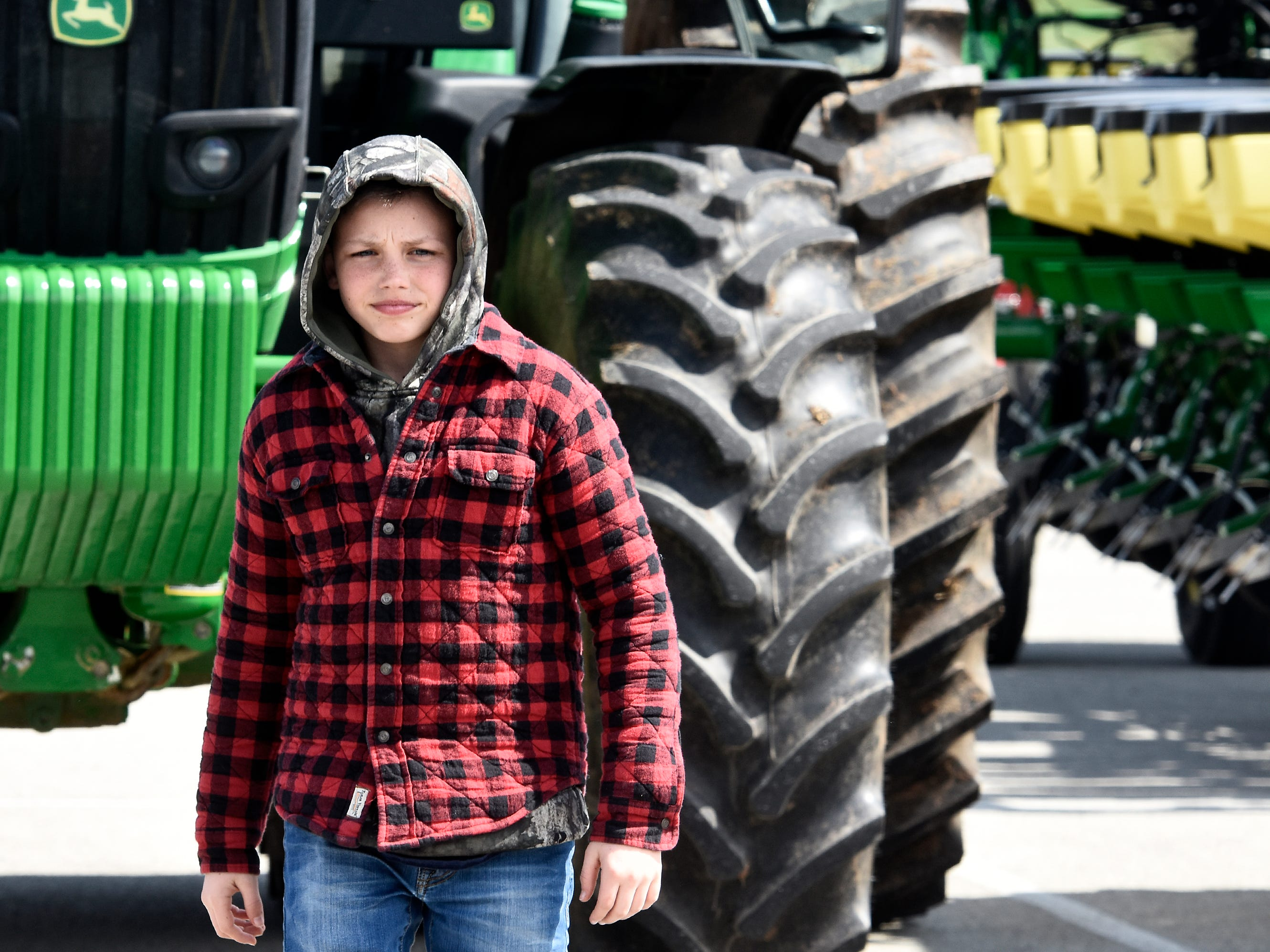 Future Farmers Club members helped out during the district's 6th Annual Rollin' Tractor Show Thursday, April 11, 2019. The show is presented by the Future Farmers Club. Alumni and area residents brought farm equipment to display with the goal of acquainting students with the agriculture industry. The show, which included a parade of equipment, visited the intermediate and elementary schools. Bill Kalina photo