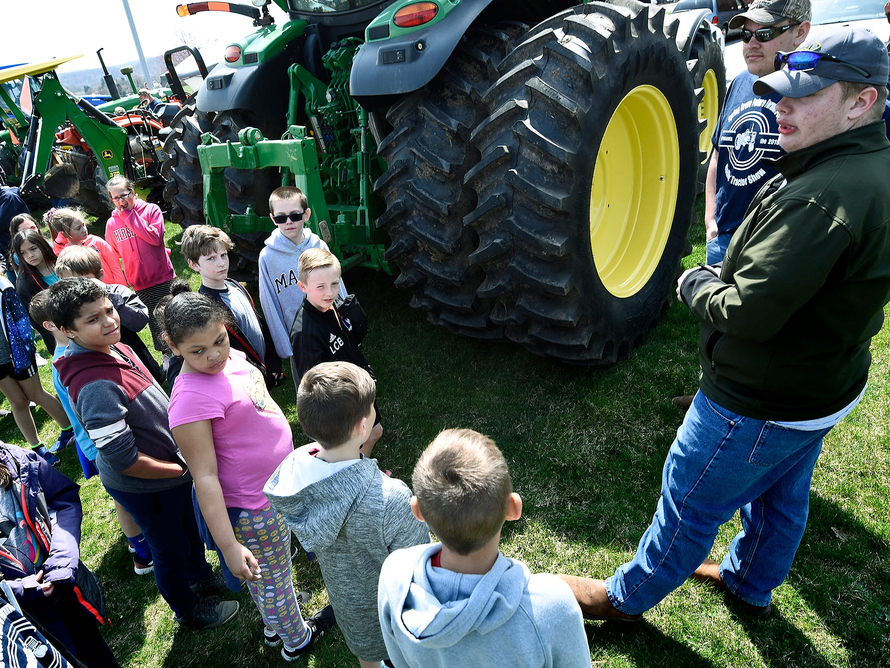 Spring Grove Elementary students listen to a presentation during the district's 6th Annual Rollin' Tractor Show Thursday, April 11, 2019, presented by the Future Farmers Club. Alumni and area residents brought farm equipment to display with the goal of acquainting students with the agriculture industry. The show, which included a parade of equipment, visited the intermediate and elementary schools. Bill Kalina photo
