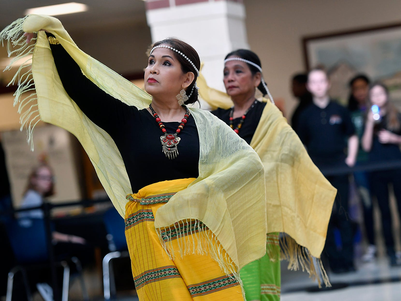 Emy Delgaudio, left, and Mila Phomas, of the Kalayaan USA Cultural Ensemble, perform traditional Filipino dance during the 13th Annual Diversity Celebration at Central York High School, Thursday, April 11, 2019.John A. Pavoncello photo
