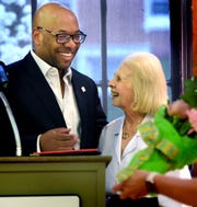 Fran Keller, Martin Library marketing director, laughs with YCL President Robert F. Lambert during a staff meeting at Martin Library Friday, April 12, 2019. Keller, who is retiring after over 32 years with the library, was presented with flowers by Lambert and the staff as a surprise during the meeting. Bill Kalina photo