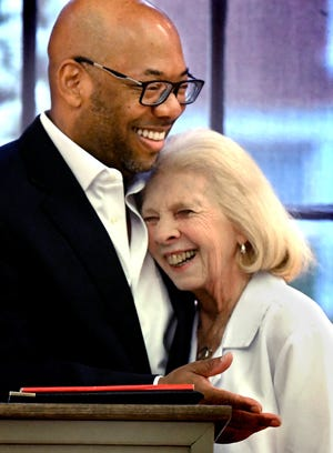 Fran Keller, Martin Library marketing director, is hugged by YCL President Robert F. Lambert during a staff meeting at Martin Library Friday, April 12, 2019. Keller, who is retiring after over 32 years with the library, was presented with flowers by Lambert and the staff as a surprise during the meeting. Bill Kalina photo