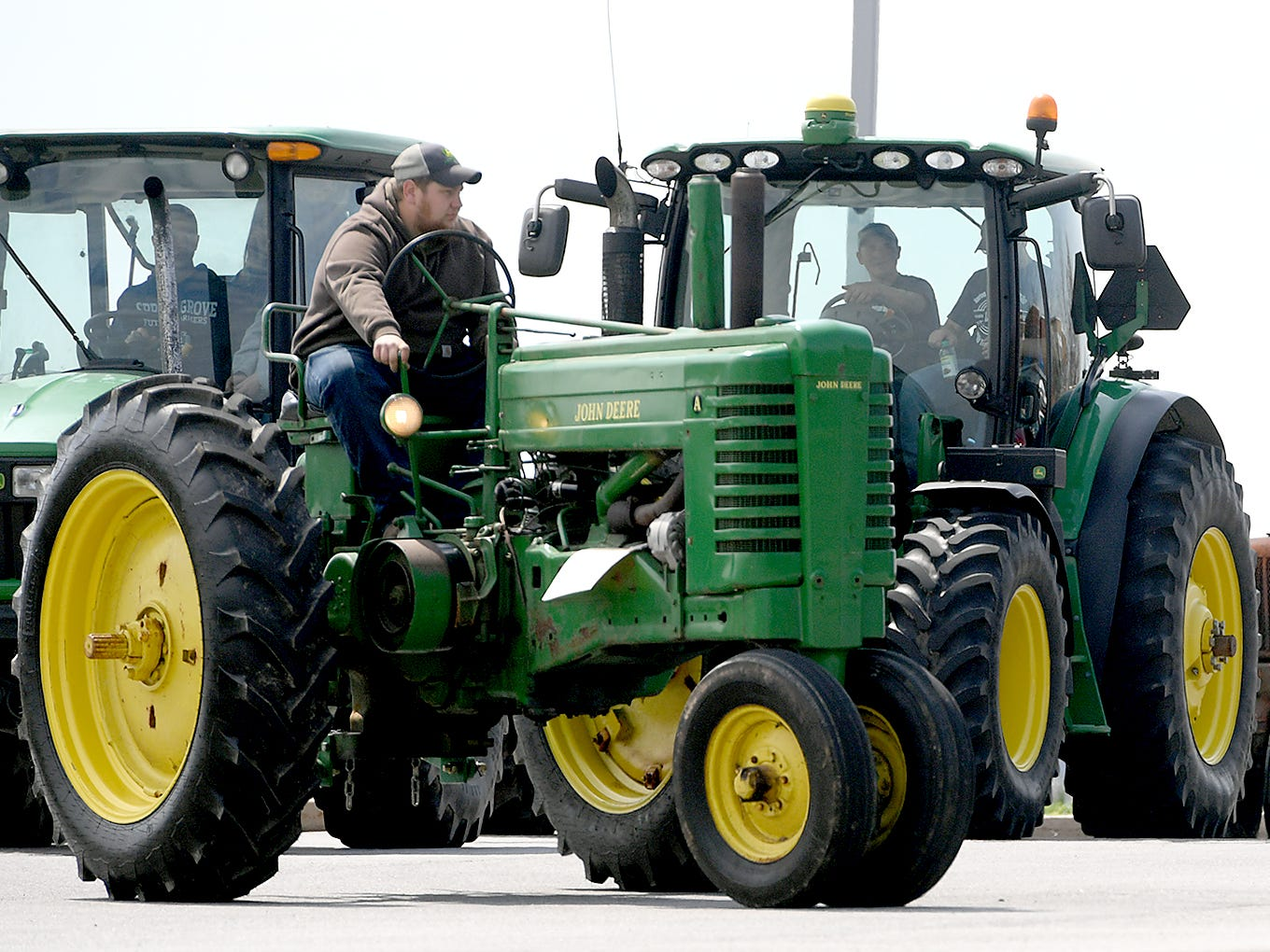 Farm equipment is situated at Spring Grove Elementary Elementary School during the district's 6th Annual Rollin' Tractor Show Thursday, April 11, 2019. The show is presented by the Future Farmers Club. Alumni and area residents brought farm equipment to display with the goal of acquainting students with the agriculture industry. The show, which included a parade of equipment, visited the intermediate and elementary schools. Bill Kalina photo