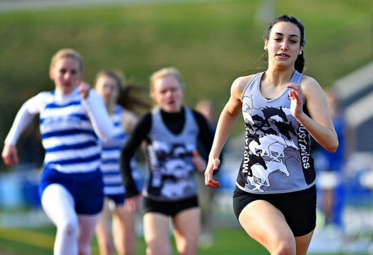 South Western's Bella Gilberto wins the Girls' 800 during track action in Jackson Township, Thursday, April 11, 2019. Dawn J. Sagert photo