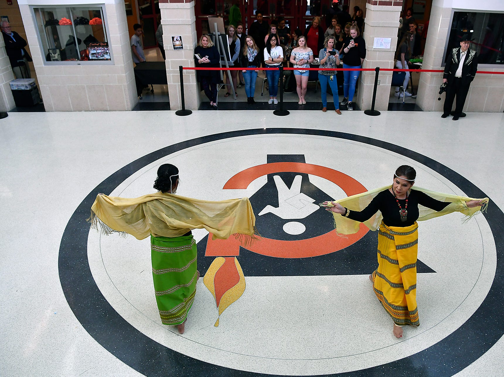 Mila Phomas, left, and Emy Delgaudio, of the Kalayaan USA Cultural Ensemble, perform traditional Filipino dance during the 13th Annual Diversity Celebration at Central York High School, Thursday, April 11, 2019.John A. Pavoncello photo