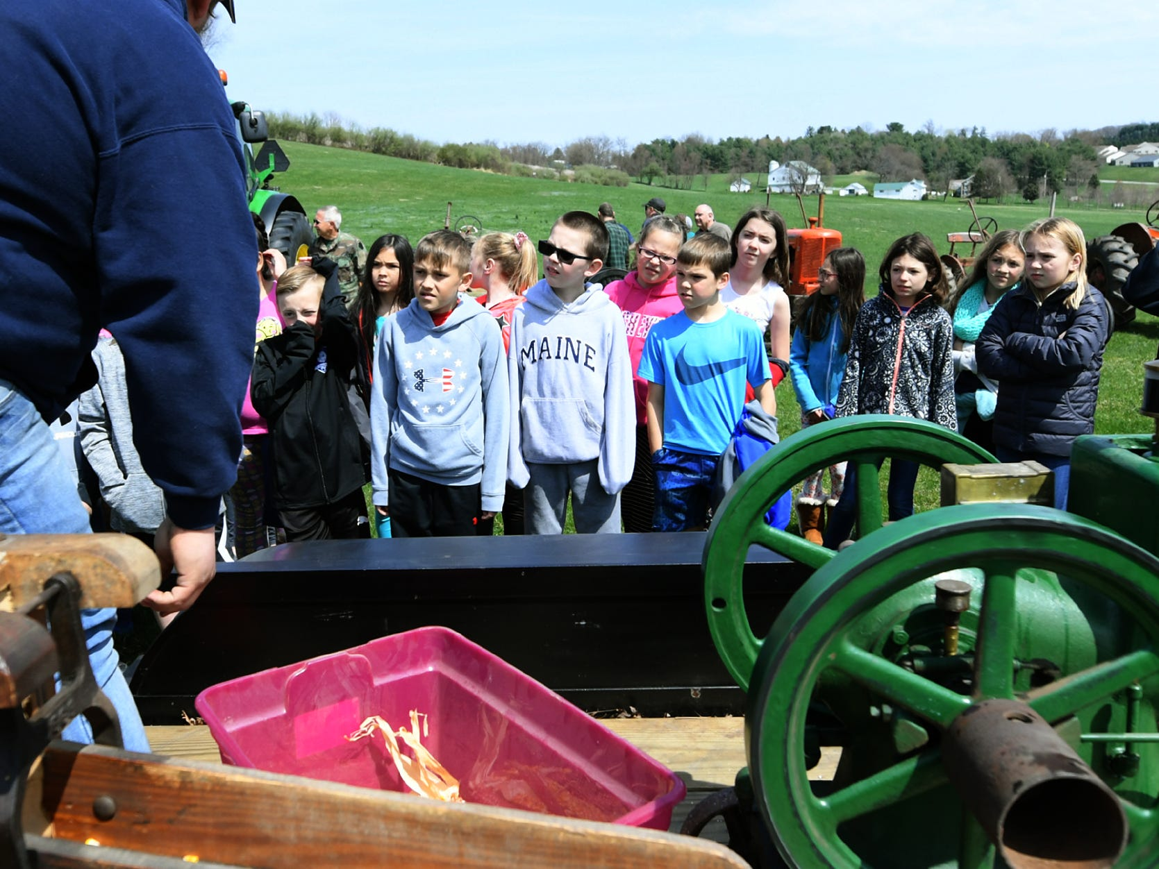 Spring Grove Elementary School students watch a demonstration during the district's 6th Annual Rollin' Tractor Show Thursday, April 11, 2019. The show is presented by the Future Farmers Club. Alumni and area residents brought farm equipment to display with the goal of acquainting students with the agriculture industry. The show, which included a parade of equipment, visited the intermediate and elementary schools. Bill Kalina photo
