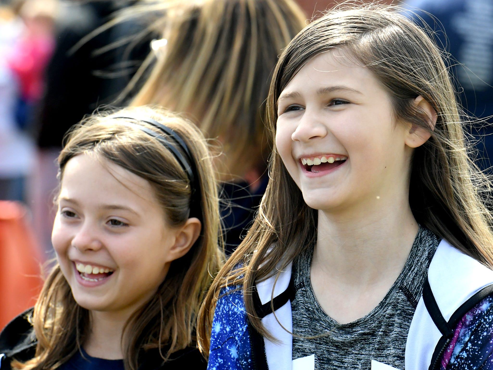 Spring Grove Elementary School fourth graders Kenley Lellers, left, and Emmye Schuman watch a demonstration during the district's 6th Annual Rollin' Tractor Show Thursday, April 11, 2019, presented by the Future Farmers Club. Alumni and area residents brought farm equipment to display with the goal of acquainting students with the agriculture industry. The show, which included a parade of equipment, visited the intermediate and elementary schools.Bill Kalina photo