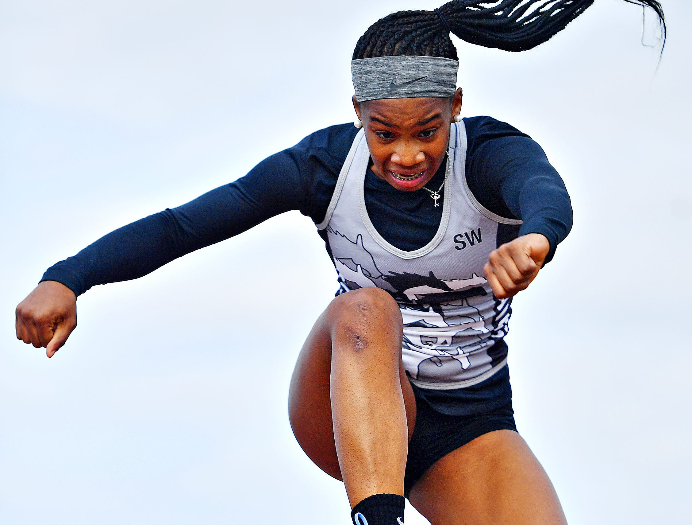 South Western's Zaiyah Marshall competes in the Triple Jump during track  & field action against Spring Grove in Jackson Township, Thursday, April 11, 2019. Dawn J. Sagert photo