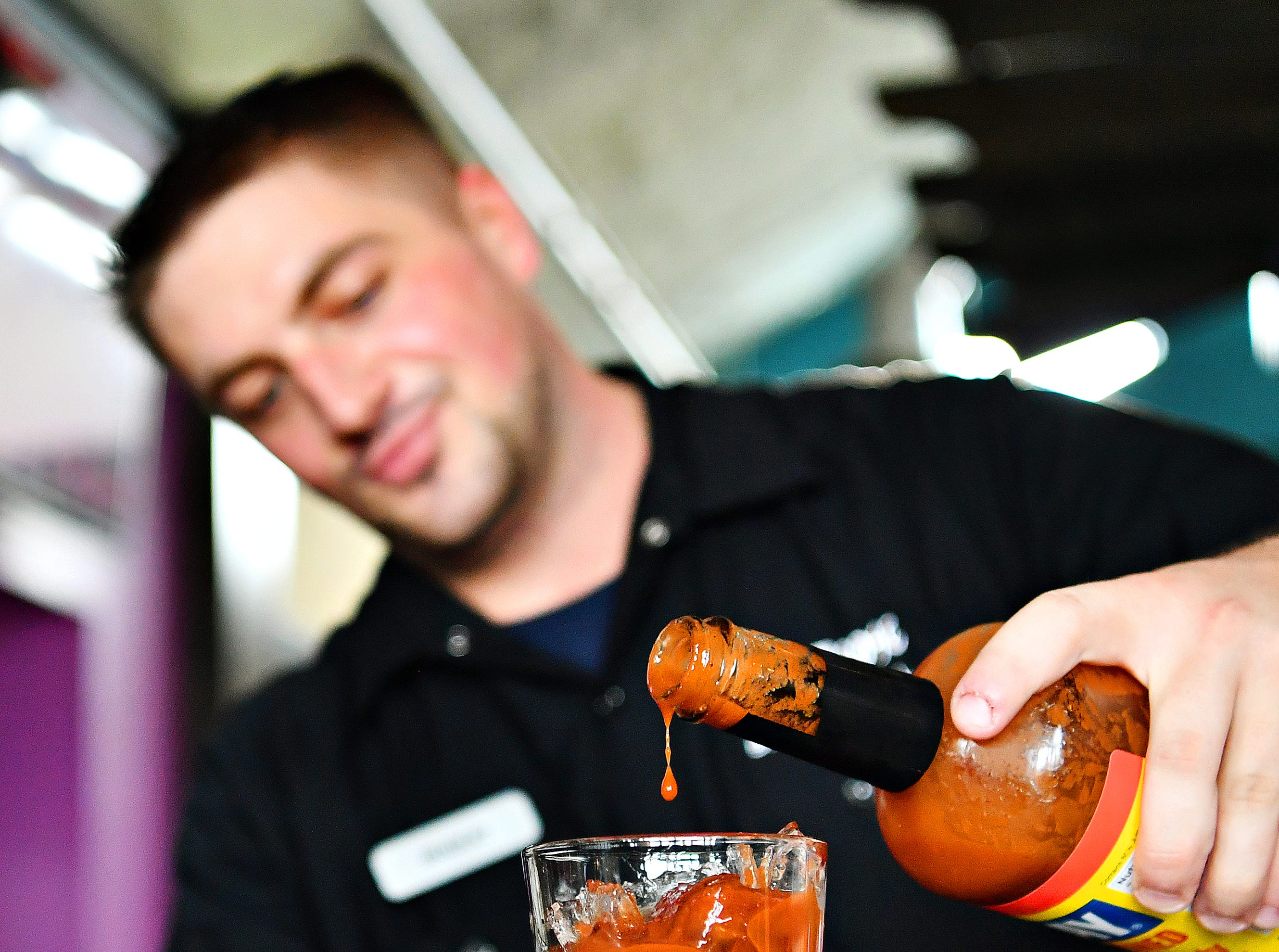 Bartender Bradley Clarkson mixes a Bloody Mary at White Rose at Bridgewater, which overlooks Bridgewater Golf Course, in York Township, Friday, April 12, 2019. Dawn J. Sagert photo