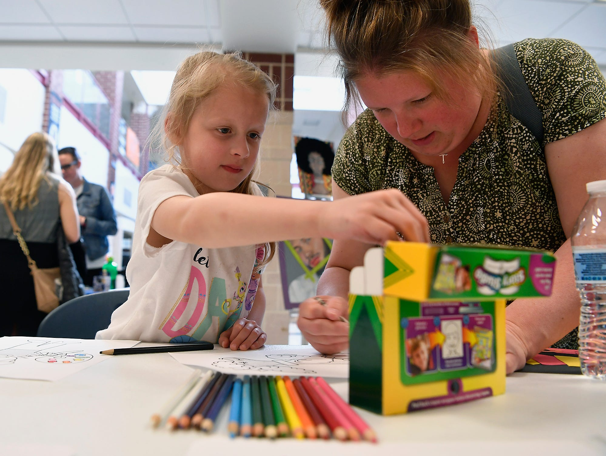 Brynn Rollman, 7, and mother Andrea, color during the 13th Annual Diversity Celebration at Central York High School, Thursday, April 11, 2019.John A. Pavoncello photo