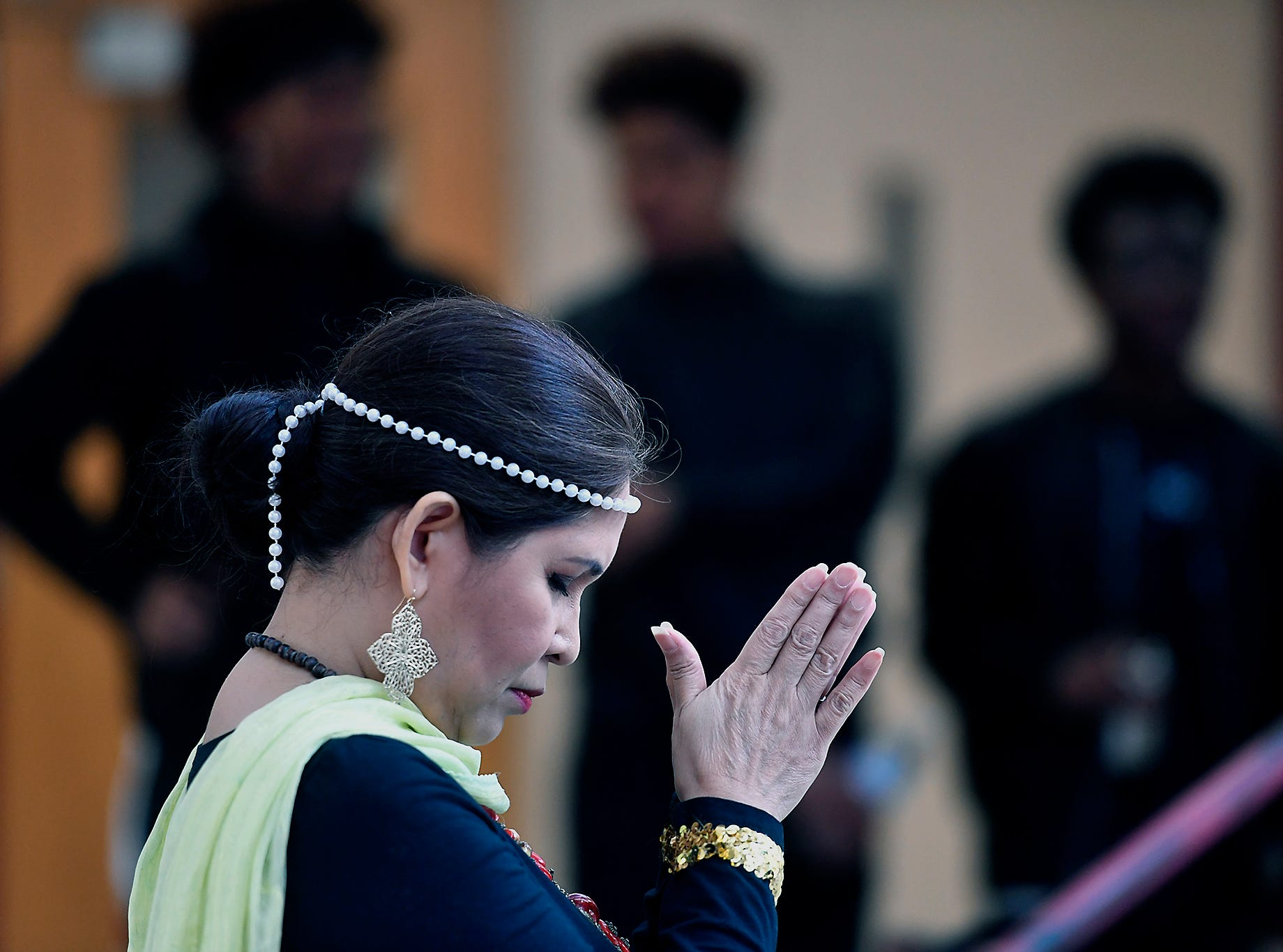 Emy Delgaudio of the Kalayaan USA Cultural Ensemble, prepares to perform traditional Filipino dance during the 13th Annual Diversity Celebration at Central York High School, Thursday, April 11, 2019.John A. Pavoncello photo