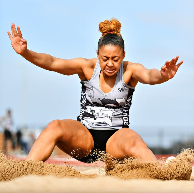 South Western's Kayla Brooks competes in the Triple Jump during track & field action against Spring Grove in Jackson Township, Thursday, April 11, 2019. Dawn J. Sagert photo