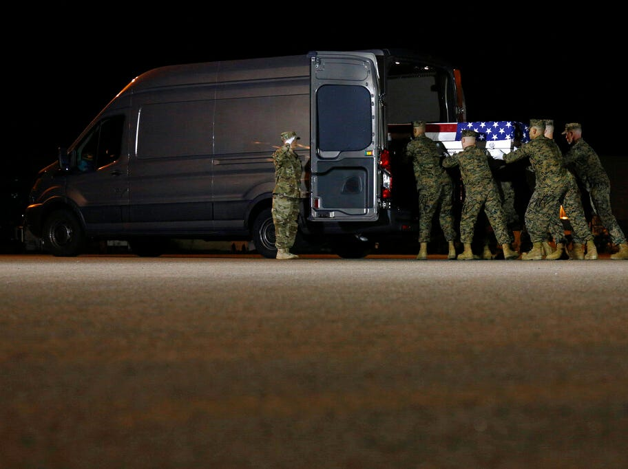 A U.S. Marine Corps carry team loads a transfer case containing the remains of Staff Sgt. Christopher A. Slutman into a vehicle, Thursday, April 11, 2019, at Dover Air Force Base, Del. According to the Department of Defense, Slutman, of Newark, Del., was among three American service members killed by a roadside bomb on Monday, April 8, 2019, near Bagram Airfield in Afghanistan. (AP Photo/Patrick Semansky)