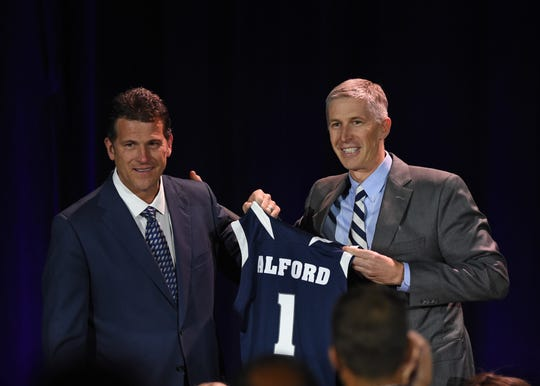 Nevada athletic Doug Knuth, right, introduces Steve Alford as the new Nevada basketball coach during a press conference at Lawlor Events Center in Reno on Friday.