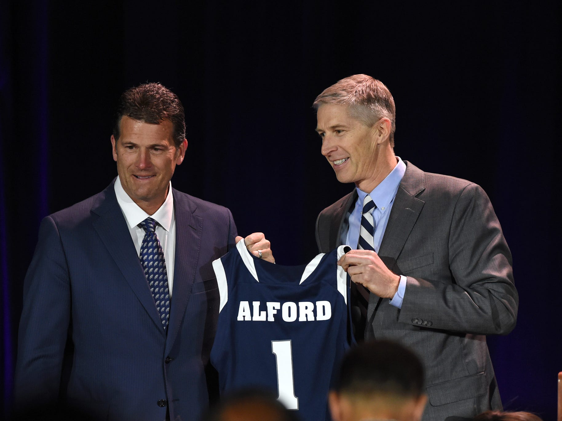 Nevada athletic Doug Knuth, right, introduces Steve Alford as the new Nevada basketball coach during a press conference at Lawlor Events Center in Reno, Nevada on April 12, 2019.