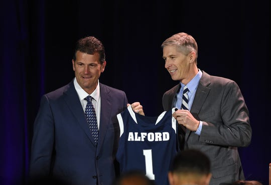 Nevada athletic Doug Knuth, right, introduces Steve Alford as the new Nevada basketball coach during a press conference at Lawor Events Center in Reno, Nevada on April 12, 2019.