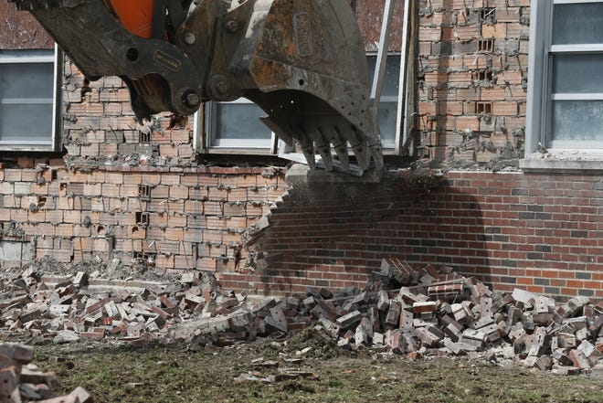 Demolition continues on the Milton School building on Thursday, April 12, 2019. Milton stopped being a high school after consolidation with Cambridge City.