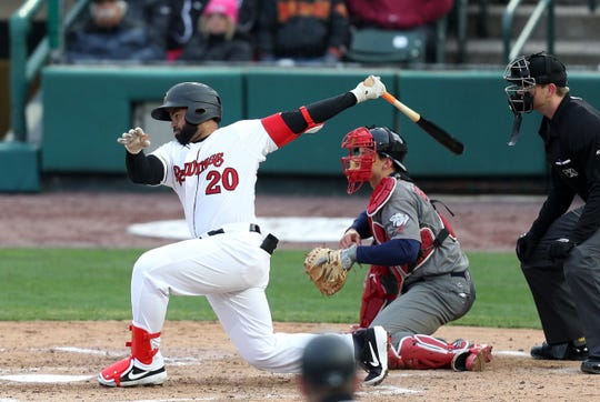 Red Wings first baseman Wilin Rosario swings and misses.
