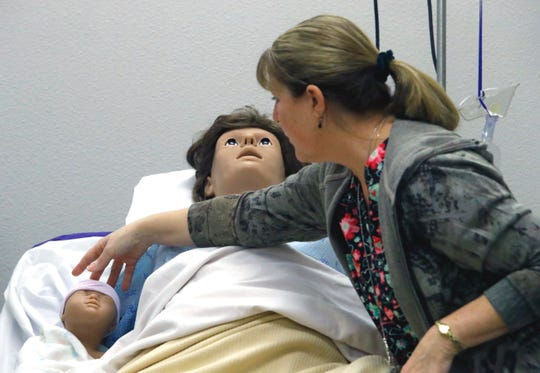 Vocational nursing instructor Nancy Skaggs of Shasta College positions a baby manikin next to its simulated mother at the college's health sciences facility in downtown Redding.