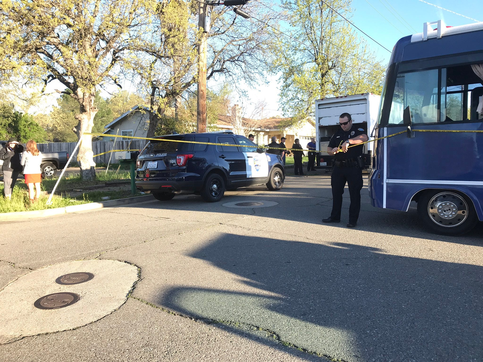 A Redding police officer on Friday, April 12, 2019 cordoned off a neighborhood in the area of Oxford Road and Derby Lane. A man has holed himself up inside a home in the 2100 block of Oxford.