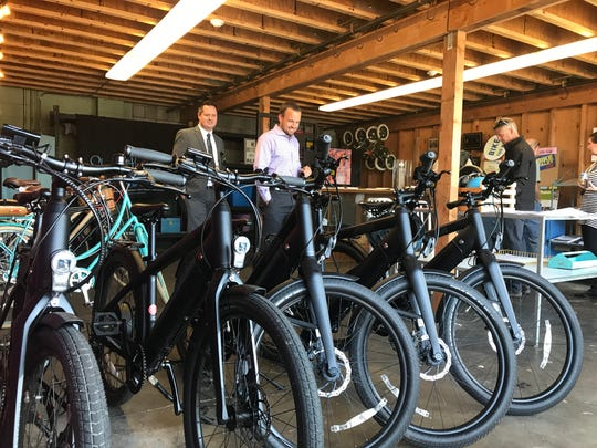 Members of Redding East Rotary check out the bikes inside California Street Labs in downtown Redding.