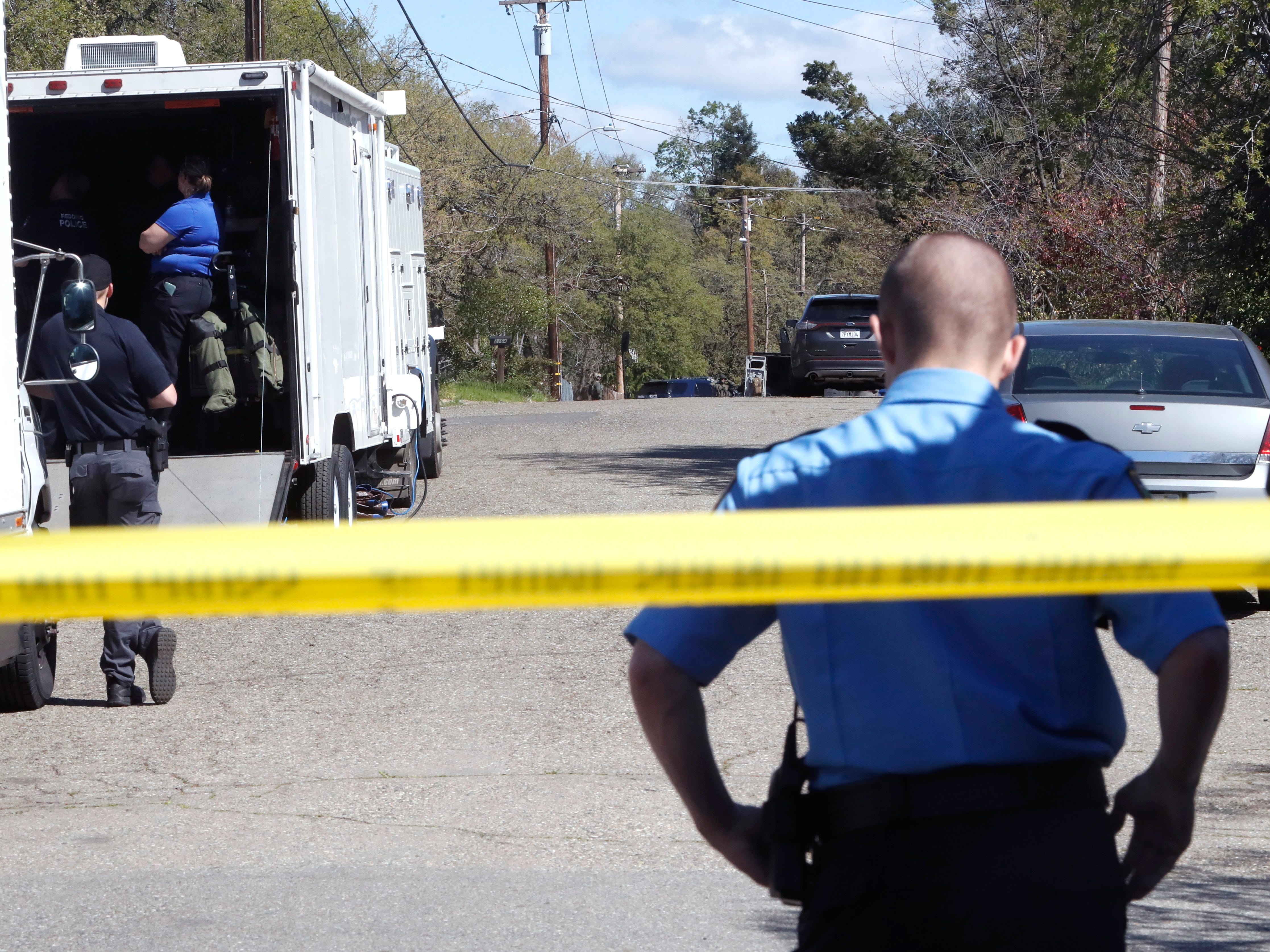 Police block Oxford Road in east Redding where a gunman holed up before surrendering.
