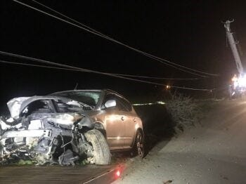 This front of this Nissan Murano was crushed after the driver hit power poles Thursday night. The driver, Justin James Knapp, was arrested on suspicion of DUI.