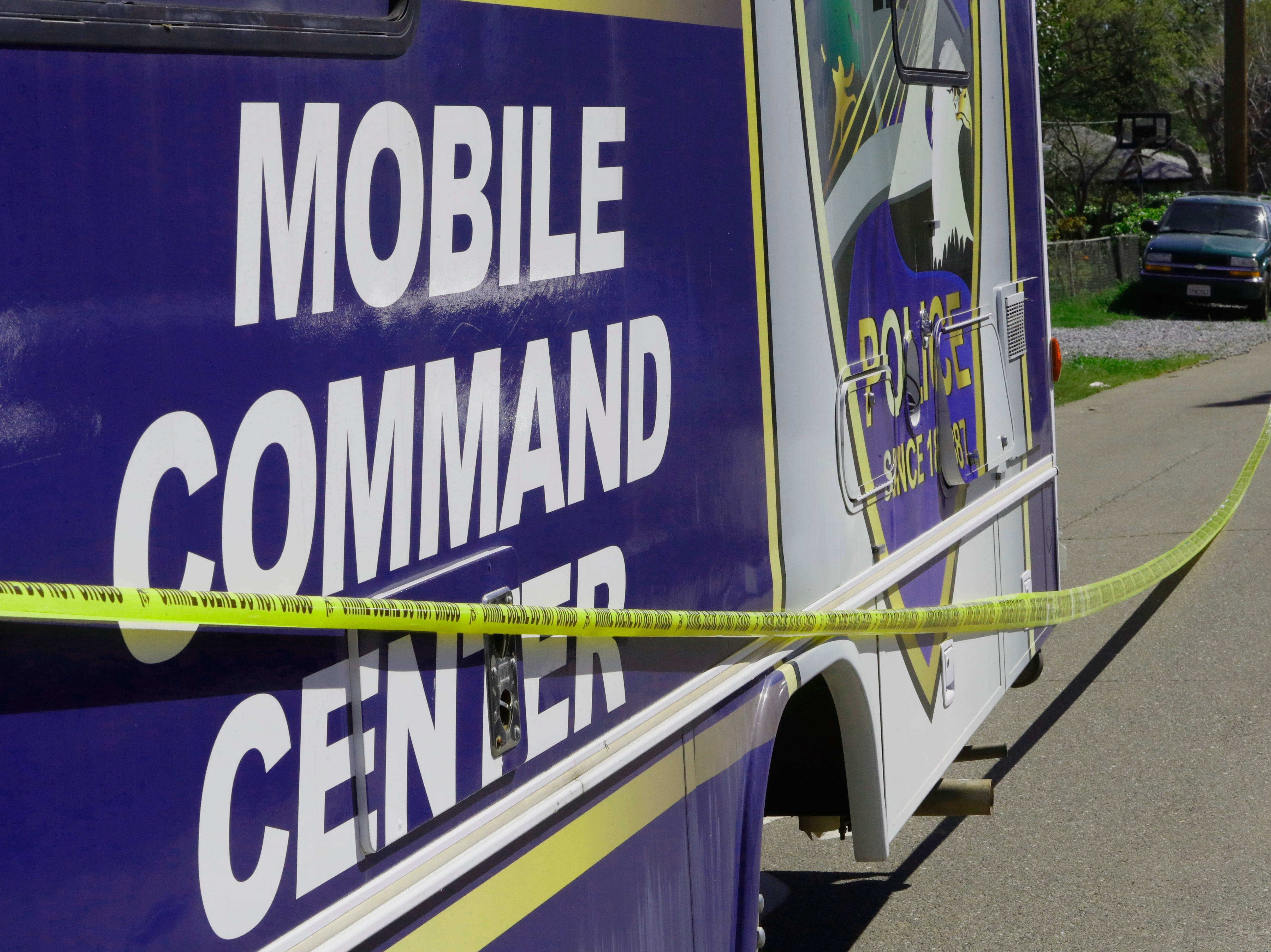 Redding police set up a mobile command center at Oxford Road and Derby Lane after a man fired a gun inside a house Friday.