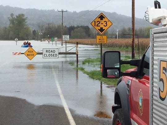 Firefighters rescued a man who got stuck in the Willamette River flood while driving from Salem to Independence Wednesday evening near Orville Road S.