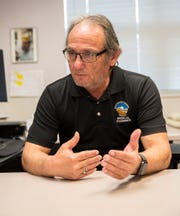 George Lovato, Washington County death investigator, talks during an interview in the county medical examiner's office.